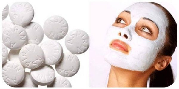 Таблетки Аспирин и маска на лице девушки